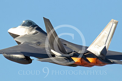 AB - F-22 00062 A USAF Lockheed Martin F-22 Raptor stealth fighter, OT 06120, with under-wing fuel tanks takes off in afterburner at Nellis AFB, by Peter J Mancus