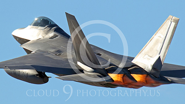 AB - F-22 00062A A USAF Lockheed Martin F-22 Raptor stealth fighter, OT 06120, with under-wing fuel tanks takes off in afterburner at Nellis AFB, by Peter J Mancus