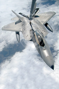 An F-22 Raptor from Elmendorf Air Force Base, Alaska, takes gas from a KC-135 Stratotanker July 27, 2010. By flying with a tanker, the fighter could routinely fill its fuel tanks to ensure it had enough fuel to reach a safe base in the event it had to land. The tanker is assigned to the 100th Air Refueling Wing at Royal Air Force Lakenheath, England. (U.S. Air Force photo/Staff Sgt. Austin M. May)