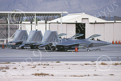 F-22USAF 00421 A static line up of three Lockheed Martin F-22 Raptors USAF 01024 TY code Nellis AFB 12-2003 military airplane picture by Michael Grove, Sr