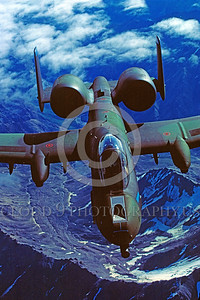 A-10USAF 00005 A Fairchild A-10 Thunderbolt II USAF attack jet lizard color scheme flies over Alaska 8-1984 military airplane picture by Peter J Mancus
