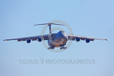C-5USAF 0060 A landing low viz gray Lockheed C-5B Galaxy USAF heavy lift cargo jet military airplane picture by Peter J Mancus