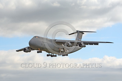 C-5USAF 0054 A landing low viz gray Lockheed C-5B Galaxy USAF heavy lift cargo jet military airplane picture by Peter J Mancus