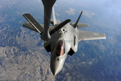 AR-F-35-USAF 002 A Lockheed Martin F-35 Lightning II stealth jet fighter doing aerial refueling over mountains, official USAF picture produced by Cloud 9 Photography     Dt