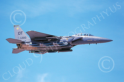 F-15EUSAF 00052 A flying McDonnell Douglas F-15E Strike Eagle USAF 96200 OT code with bombs 4-2003 military airplane picture by Michael Grove, Sr