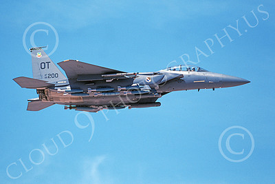 F-15EUSAF 01000 A flying McDonnell Douglas F-15E Strike Eagle USAF 96200 OT code with bombs 4-2003 military airplane picture by Michael Grove, Sr