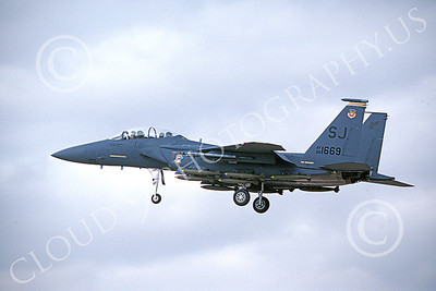 F-15EUSAF 00056 A landing McDonnell Douglas F-15E Strike Eagle USAF 881669 SJ code with bombs 1-1990 military airplane picture by Michael Grove, Sr