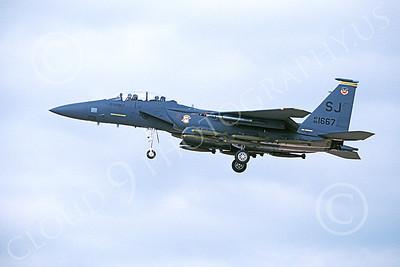 F-15EUSAF 00054 A landing McDonnell Douglas F-15E Strike Eagle USAF 881667 SJ code with bombs 1-1990 by Michael Grove, Sr