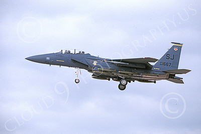 F-15EUSAF 01002 A landing McDonnell Douglas F-15E Strike Eagle USAF 881667 SJ code with bombs 1-1990 military airplane picture by Michael Grove, Sr