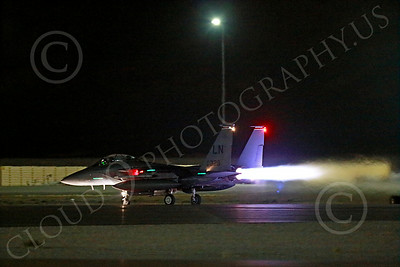 AB-F-15USAF 00151 A LN code USAF McDonnell Douglas F-15E Strike Eagle takes off in full afterburner for a night Red Flag mission at Nellis AFB 7-2014 military airplane picture by Peter J Mancus