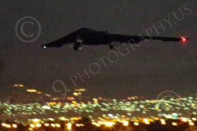 WWAN 00053 A Northrop B-2 Spirit USAF stealth strategic bomber climbs out after take-off from Nellis AFB for a night Red Flag mission military airplane picture by Peter J Mancus