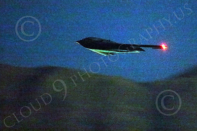 WWAN 00046 A Northrop B-2 Spirit USAF stealth strategic bomber climbs out during take-off from Nellis AFB for a night Red Flag mission military airplane picture by Peter J Mancus