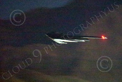 WWAN 00039 A Northrop B-2 Spirit USAF stealth strategic bomber climbs out during take-off from Nellis AFB for a night Red Flag mission military airplane picture by Peter J Mancus