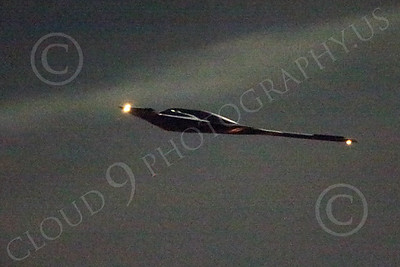 WWAN 00049 Like a black boomerrang slicing through the night sky a Northrop B-2 Spirit USAF stealth strategic bomber flies during a night Red Flag mission military airplane picture by Peter J Mancus