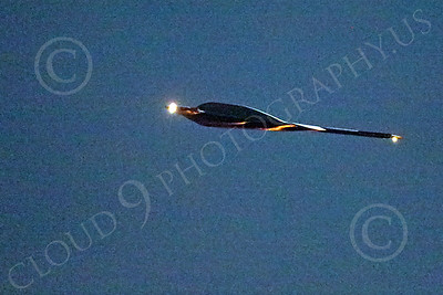 WWAN 00015 A Northrop B-2 Spirit USAF stealth strategic bomber climbs out after take-off from Nellis AFB for a night Red Flag mission military airplane picture by Peter J Mancus