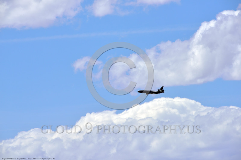 KC-10USAF 00032 A large flying Douglas KC-10 EXTENDER USAF aerial refueling jet tanker looks small in a big sky 4-2016 military airplane picture by Peter J  Mancus