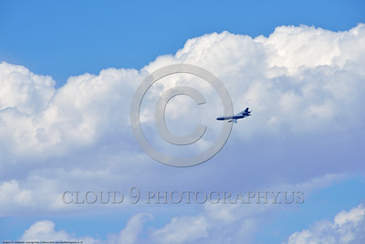 KC-10USAF 00035 A flying Douglas KC-10 EXTENDER USAF banks to turn in front of a large cloud mass 4-2016 military airplane picture by Peter J  Mancus