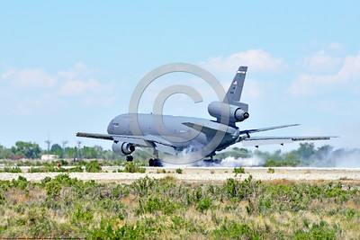 KC-10USAF 00007 A Douglas KC-10 EXTENDER USAF 30080 from Travis AFB jet aerial refueler and cargo transport aircraft turns rubber into a lot of smoke while landing at NAS Fallon 4-2016 military airplane picture by Peter J  Mancus