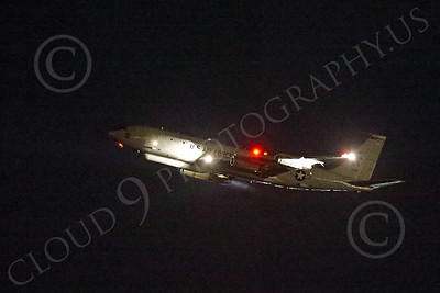WWAN 00054 A Boeing E-8 Joint STARS airborne ground battle surveillance aircraft climbs out after taking off from Nellis AFB for a night Red Flag mission military airplane picture by Peter J Mancus