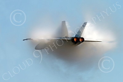 AB - F-18USN-S 00048 A US Navy Boeing F-18 Super Hornet jet fighter in full afterburner creates a dramatic, massive moisture build-up, by Peter J Mancus