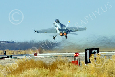 Boeing F-18F-USN 00294 A Boeing F-18F Super Hornet USN VFA-2 BOUNTY HUNTERS CAG NE code commanding officer's airplane USS Ronald Reagan takes off in afterburner at NAS Fallon 2-2015 military airplane picture by Peter J Mancus