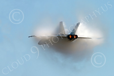 AB - F-18USN-S 00016 A US Navy Boeing F-18 Super Hornet jet fighter in full afterburner creates a dramatic, massive moisture build-up, by Peter J Mancus