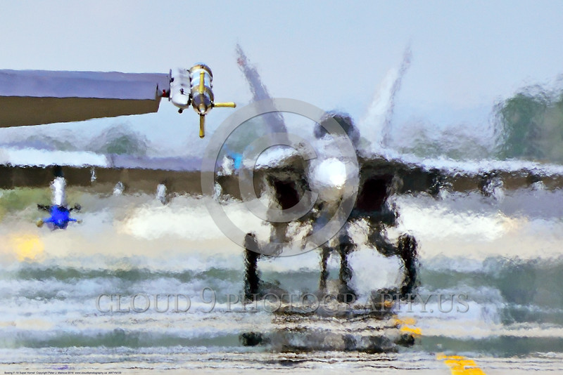 ARTYM 00005 A taxing USN Boeing F-18E Super Hornet behind other jet fighters is awashed in jet exhaust heat waves at NAS Fallon 4-2016 ahed of two Boeing F-18 Super Hornet military airplane picture by Peter J  Mancus