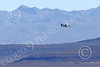 E-2USN 00260 A Grumman E-2 Hawkeye US Navy banks to land at NAS Fallon 1-2015 military airplane picture by Peter J Mancus