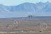 E-2USN 00254 A Grumman E-2 Hawkeye US Navy lands at NAS Fallon with aggressor aircraft waiting to take the runway 1-2015 military airplane picture by Peter J Mancus