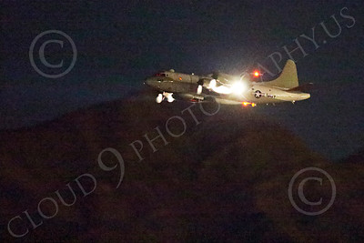 WWAN 00002 A Lockheed EP-3E Aries signals recon electronic warfare aircraft climbs out after taking off at Nellis AFB for a night Red Flag mission military airplane picture by Peter J Mancus