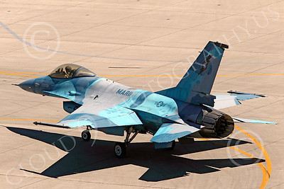 TOPG 00018 Lockheed Martin F-16 US Navy 900942 TOP GUN Navy Fighter Weapons School taxies back to its assigned parking spot at NAS Fallon, Nevada, by Peter J Mancus