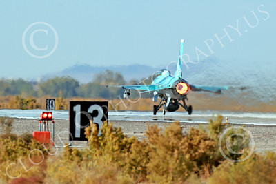 AB-F-16USN 00013 A blue Lockheed Martin F-16 Fighting Falcon jet fighter USN TOP GUN takes off in afterburner at NAS Fallon 10-2013 military airplane picture by Peter J Mancus