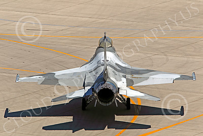 TOPG 00026 Lockheed Martin F-16 US Navy 920408 TOP GUN Navy Fighter Weapons School taxies back to its assigned parking spot at NAS Fallon, Nevada, by Peter J Mancus
