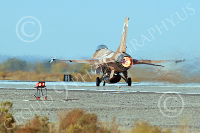 AB-F-16USN 00011 A brown Lockheed Martin F-16 Fighting Falcon USN TOP GUN in afterburner NAS Fallon 10-2013 military airplane picture by Peter J Mancus