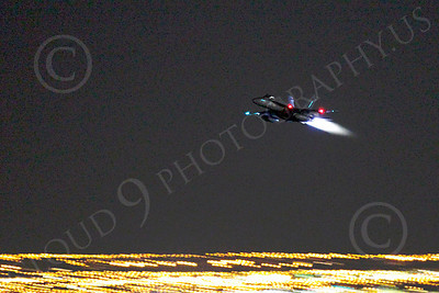 AB - F-18USN-L 00016 McDonnell Douglas F-18 Hornet US Navy in afterburner at night by Peter J Mancus