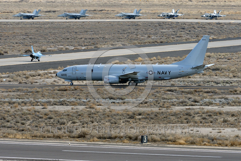 P-8USN 00005 A Boeing P-8 Poseidon USN multi-mission aircraft taxis for take-off at a busy NAS Fallon 3-2017 military airplane picture by Peter J Mancus