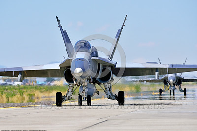 F-18A-USN-0003 Two USN McDonnell Douglas F-18A Hornet jet fighters taxi for take-off at NAS Fallon 4-2016 ahed of one Boeing F-18 Super Hornet military airplane picture by Peter J  Mancus