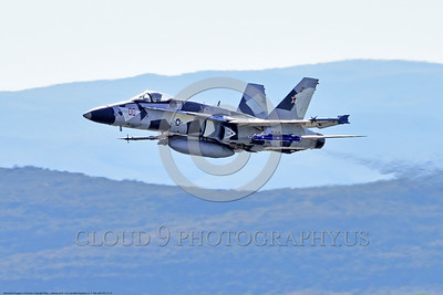 F-18A-USN-VFC-12 0014 A McDonnell Douglas F-18A USN VFC-12 FIGHTING OMARS adversary jet fighter in artic splinter livery climbs out after take-off at NAS Fallon 4-2016 ahed of one Boeing F-18 Super Hornet military airplane picture by Peter J  Mancus