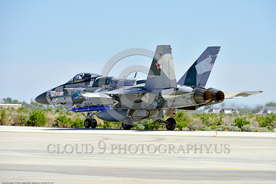 F-18A-USN-VFC-12 0003 A McDonnell Douglas F-18A USN 162867 VFC-12 FIGHTING OMARS adversart jet fighter in artic splinter livery taxis at NAS Fallon 4-2016 ahed of one Boeing F-18 Super Hornet military airplane picture by Peter J  Mancus