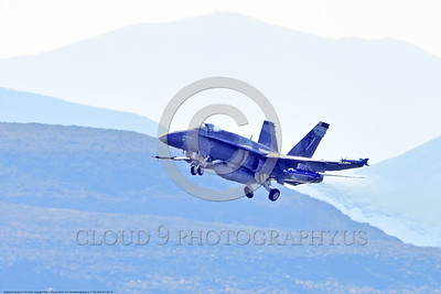 F-18A-USN-VFA-204 0012 A McDonnell Douglas F-18A USN VFA-204 RIVER RATTLERS jet fighter rotates its undercarriage after take-off at NAS Fallon 4-2016 ahed of one Boeing F-18 Super Hornet military airplane picture by Peter J  Mancus