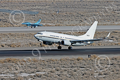 C-40USN 00002 A Boeing C-40 Clipper USN 5833 without markings takes off from NAS Fallon 1-2015 military airplane picture by Peter J Mancus