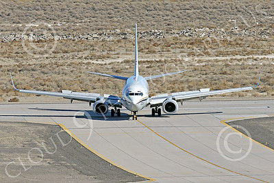 C-40USN 00011 A Boeing C-40 Clipper USN 5833 without markings taxis at NAS Fallon 1-2015 military airplane picture by Peter J Mancus