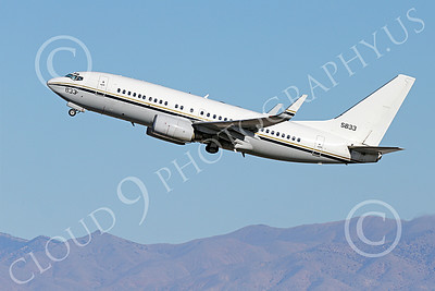 C-40USN 00008 A Boeing C-40 Clipper USN 5833 without markings climbs out after taking off from NAS Fallon 1-2015 military airplane picture by Peter J Mancus