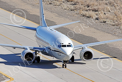 C-40USN 00007 A Boeing C-40 Clipper USN 5833 without markings taxis at NAS Fallon 1-2015 military airplane picture by Peter J Mancus