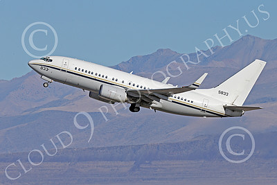 C-40USN 00006 A Boeing C-40 Clipper USN 5833 without markings climbs out after taking off from NAS Fallon 1-2015 military airplane picture by Peter J Mancus