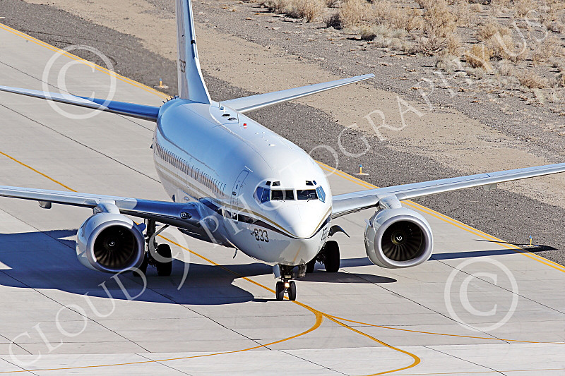 C-40USN 00013 A Boeing C-40 Clipper USN 5833 without markings taxis at NAS Fallon 1-2015 military airplane picture by Peter J Mancus