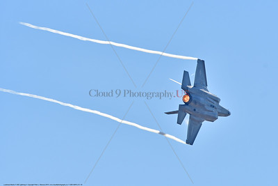 F-35B-VMFA-211 00016 A flying Lockheed Martin F-35B stealth jet fighter USMC 168840 VMFA-211 AVENGERS with wing tip vortex in afterburner MCAS Miramar 9-2016 military airplane picture by Peter J  Mancus