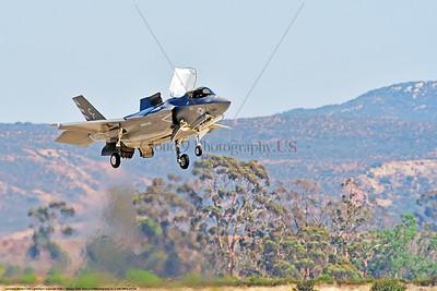 F-35B-VMFA-211 00030 A flying Lockheed Martin F-35B stealth jet fighter USMC 168840 VMFA-211 AVENGERS in VSTOL landing mode MCAS Miramar 9-2016 military airplane picture by Peter J  Mancus