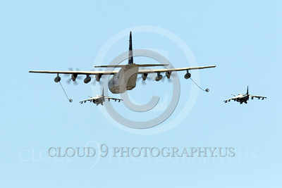 AAR 00104 A USMC Lockheed KC-130 Hercules and two USMC McDonnell Douglas AV-8B VSTOL jet attack aircraft prepare to aerial refuel airplane picture, by Peter J Mancus