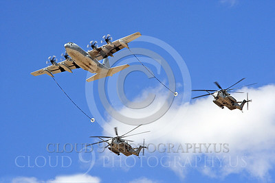 AAR 00113 A USMC Lockheed KC-130 Hercules and two USMC Sikorsky CH-53 Sea Stallion helicopters prepare to aerial refuel airplane picture, by Peter J Mancus